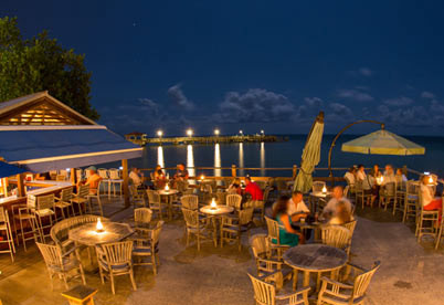 Overlooking the Atlantic Ocean, the Afterdeck is a beloved outdoor bar where you never know who you'll meet.