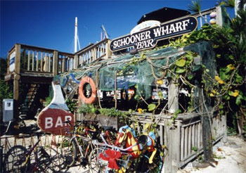 "The Schooner Wharf is an outdoor bar known for patrons who, according to their t-shirts, are ""growing old disgracefully""."