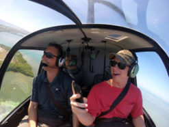 Passengers enjoying the thrill of riding in a helicopter