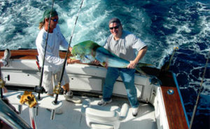 Deep sea fishing charter with mahi mahi, known locally as dolphin fish