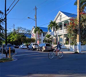 Riding a bike around the historic neighborhoods of Key West