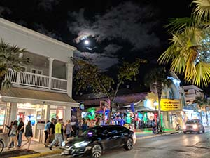 Cars driving Duval Street in Key West