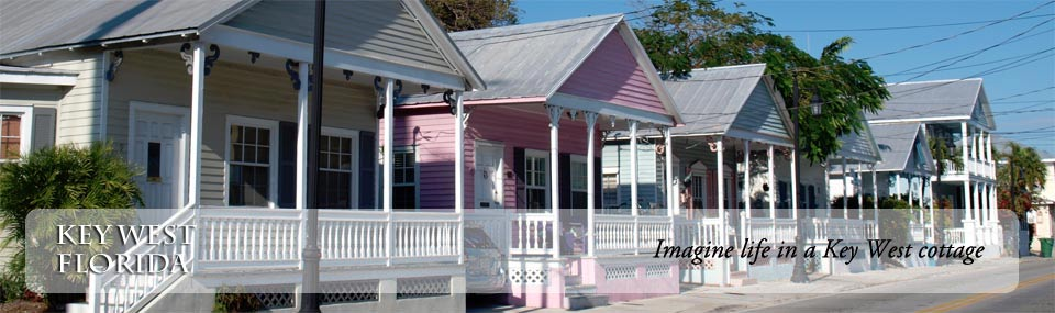View of charming Key West cottages, painted in pasted colors