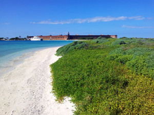 Nice beach, beautiful ocean at Dry Tortugas National Park with ferry in view