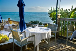 Outdoor, seaside seating at Louie's Backyard provides an exceptional fine dining experience