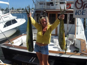 Angler with two mahi mahi, caught deep-sea fishing in Key West