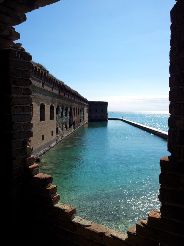 View through brick wall of the mote that surrounds Fort Jefferson in the Dry Tortugas