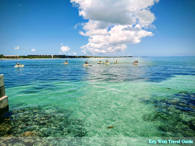 Blue skies and turquoise ocean while waverunners tour the island
