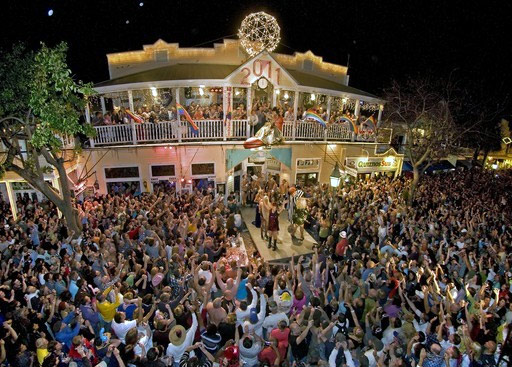View of the New Year's celebration in Key West, with drag queen riding a huge shoe