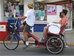 Pedi-cab riding down Duval Street