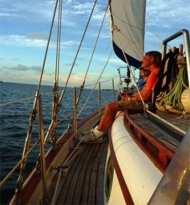 Private charter sailing along while passenger enjoys the memorable experience
