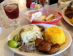 Typical meal at Cuban restaurants include roast pork and rice, as pictured here