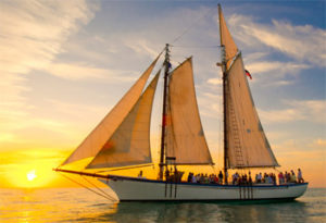 Schooner Appledore with a group watching the sun set over the ocean in Key West