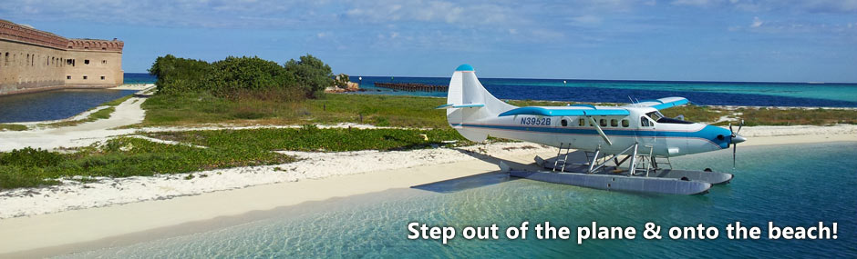 View of turquoise ocean and Fort Jefferson with seaplane in foreground
