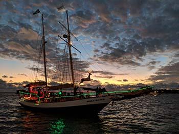 Sunset sailing boat returning to Key West harbor