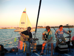 Musicians performing on the bow of the ship during sunset sail