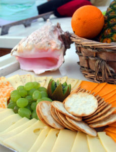 Assortment of snacks, including crackers, cheese, and fruit