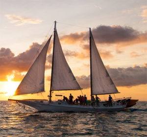 The traditional skipjack schooner, a working boat of Key West, as the sun goes down
