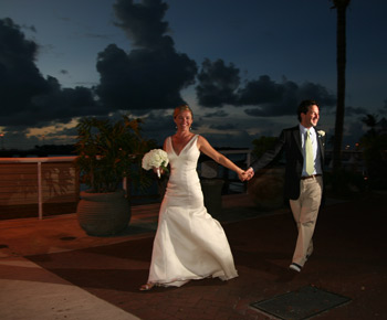 Happy couple, married in Key West, celebrates with a walk along the waterfront